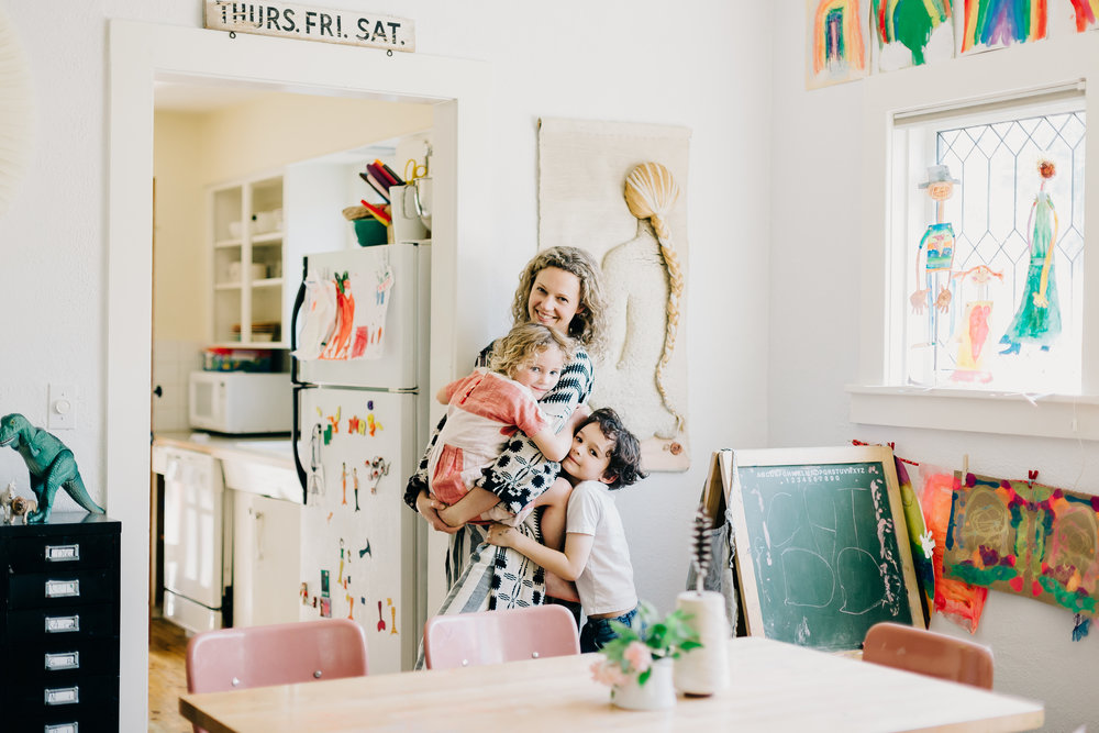 jenna from ace & jig at home surrounded by her children and art