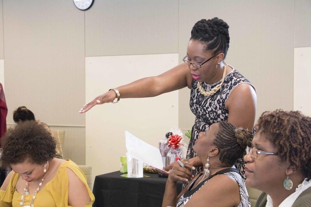 Making Straights Paths' Markita Samuel intimately teaching an audience member.