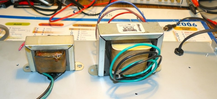 Blues Junior Output Transformer on the left and a Mercury Magnetic's Upgrade Version on the Right