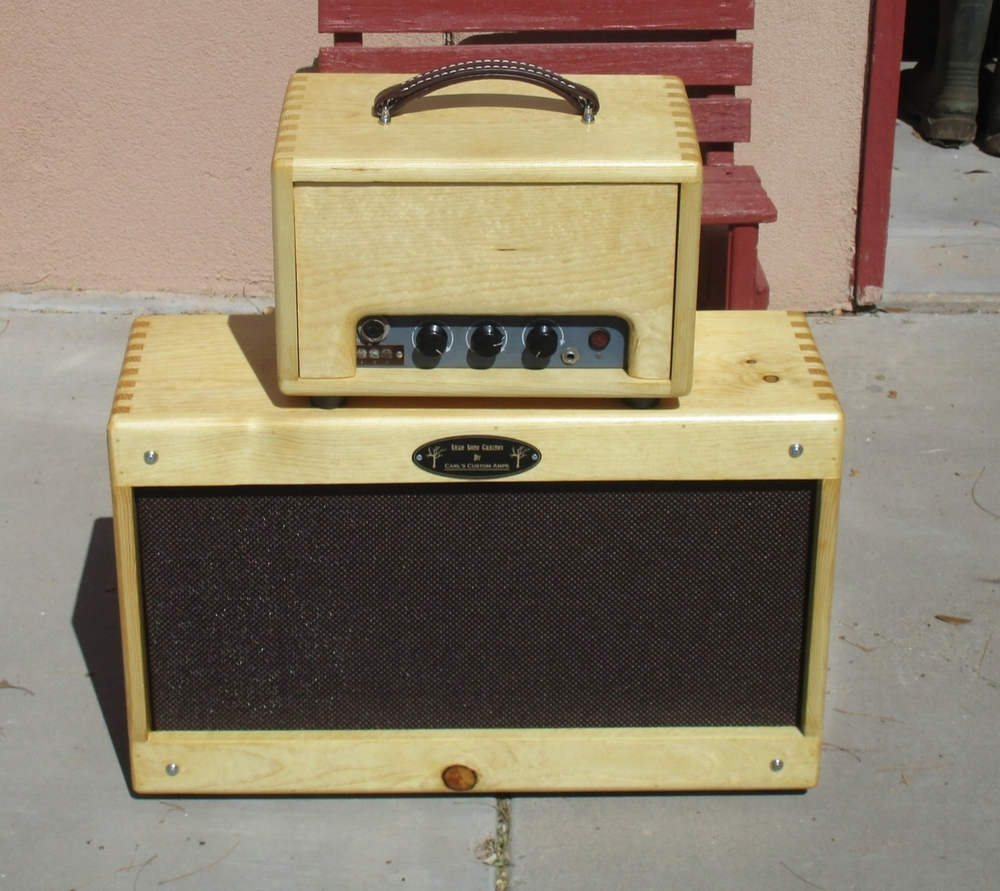 I restored this old RCA Tube amp for customer, housed it in a pine head cab and built a custom made extension cab with one 10inch and one 8 inch Weber Speaker!!! Very cool and gritty!