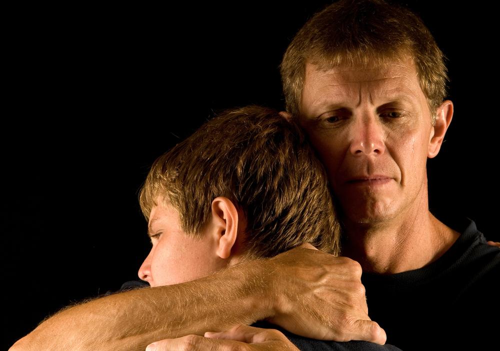 bigstock-Father-hugs-son-5655891.jpg