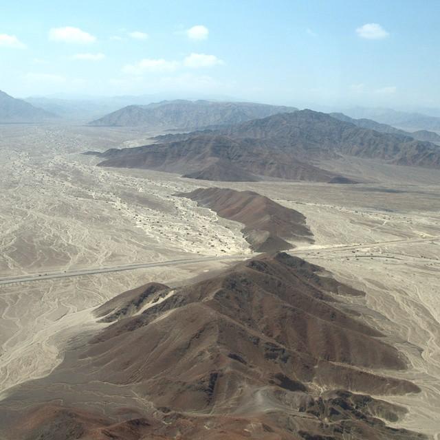 Flying over the Peruvian desert near the Nazca Lines. #traveldeeper #traveltogether #peru #nazcalines