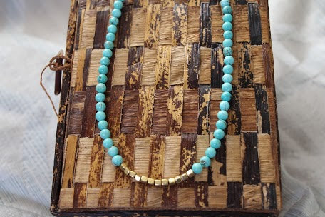 Awali Necklace 25in on Box.png