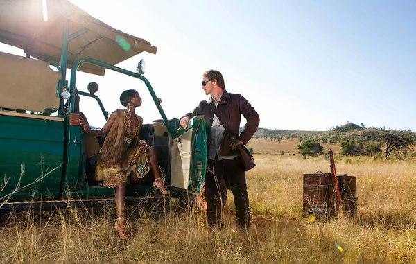 Safari man and woman with car.jpg