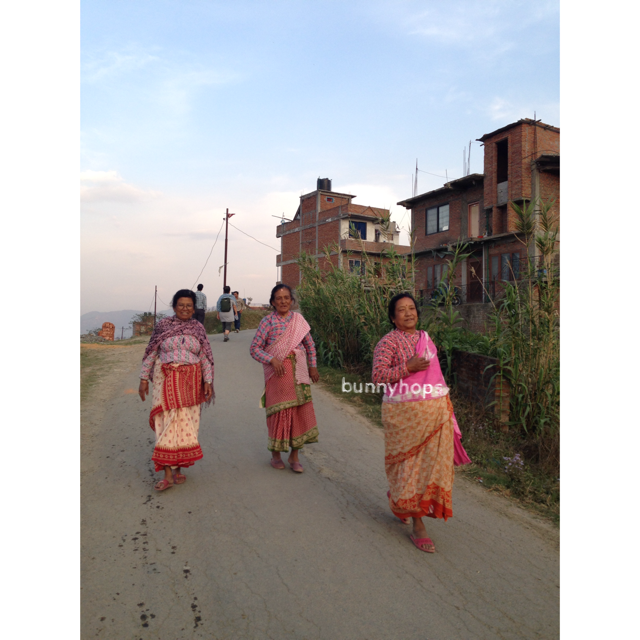 returning home after a day of festivities on the nepali national new year's day, all pretty in pink