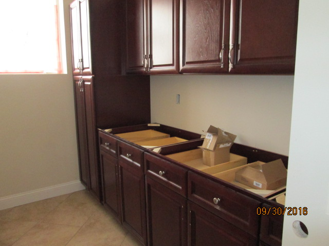 Auburn Custom Homes Palm Coast  Laundry Cabinets 1.JPG
