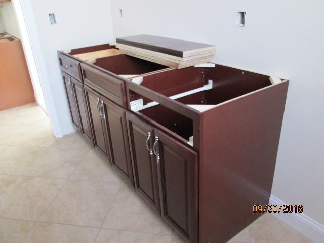 Auburn Custom Homes Palm Coast  Laundry Cabinets 2.JPG