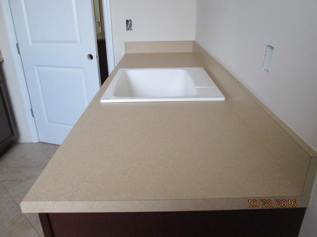 Auburn Custom Homes Palm Coast laundry Counter tops 3.JPG