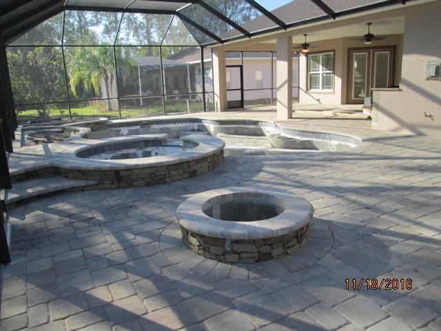Auburn Custom Homes Palm Coast Firepit and pool.JPG
