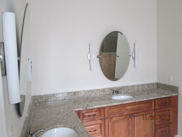 Auburn Custom Homes Palm Coast Master bath mirrors 2.JPG