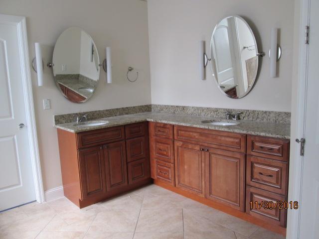 Auburn Custom Homes Palm Coast Master bath mirrors.JPG
