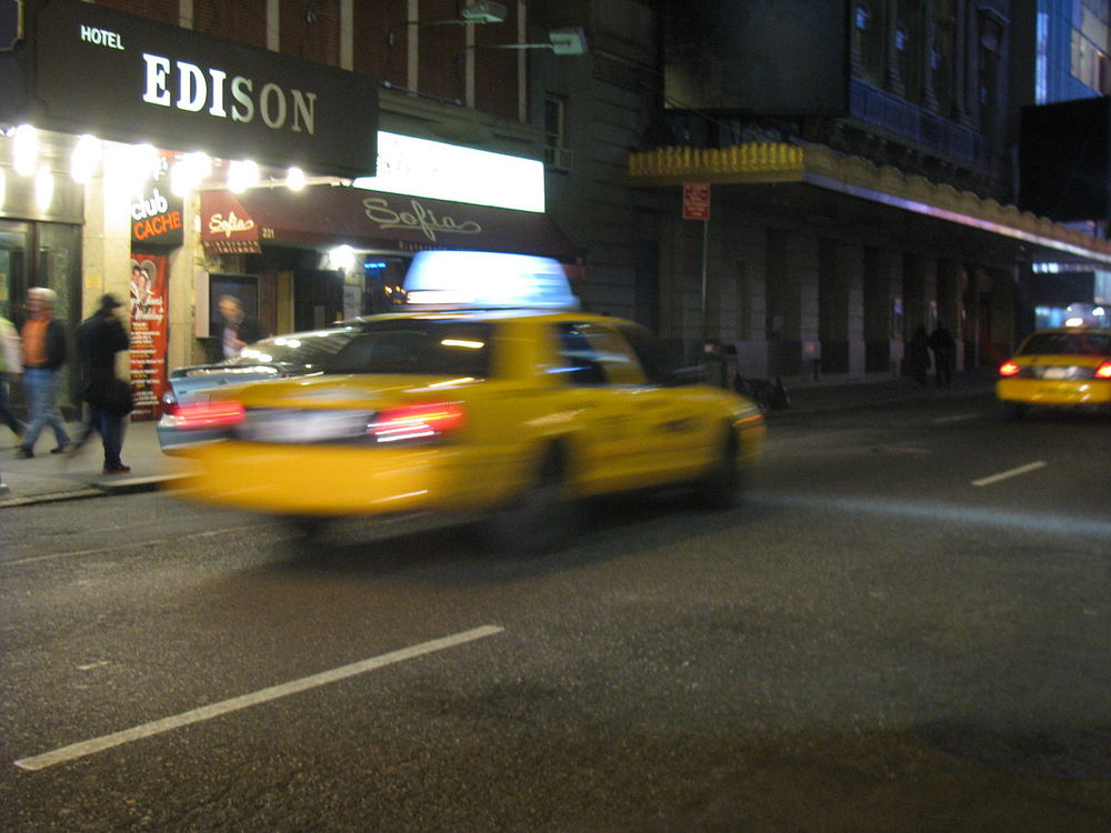 """""""NYC Taxi in motion"""", The Wordsmith (CC BY-SA 3.0 via Wikimedia Commons)"""