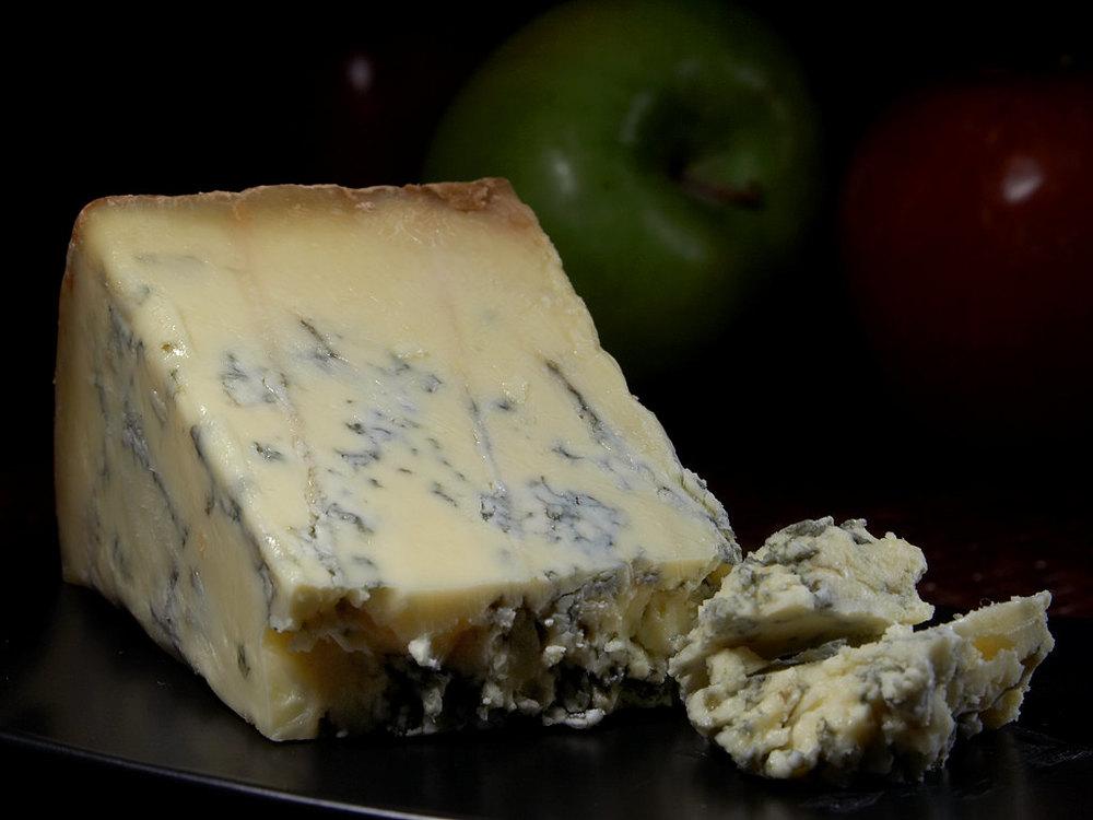 """Blue Stilton cheese"" by  Jon Sullivan  (Public Domain via  Wikimedia Commons )"