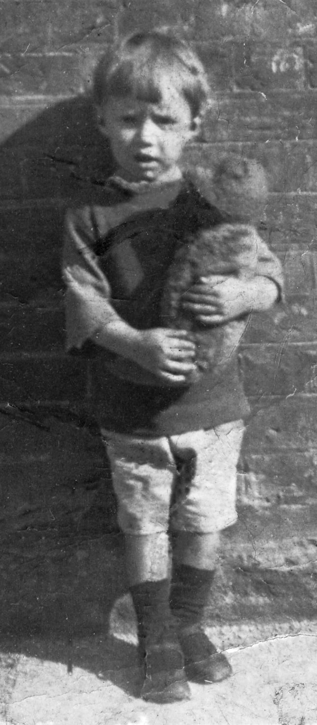 Three-year-old Des Drew clutching his precious teddy bear.