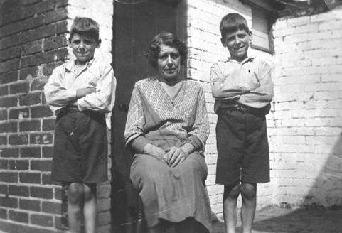 Henry (left) and Frank Webb with their mother.