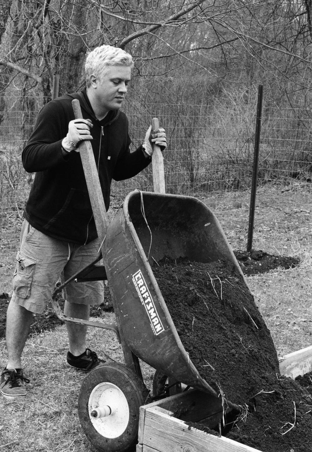 alex dumping dirt.jpg
