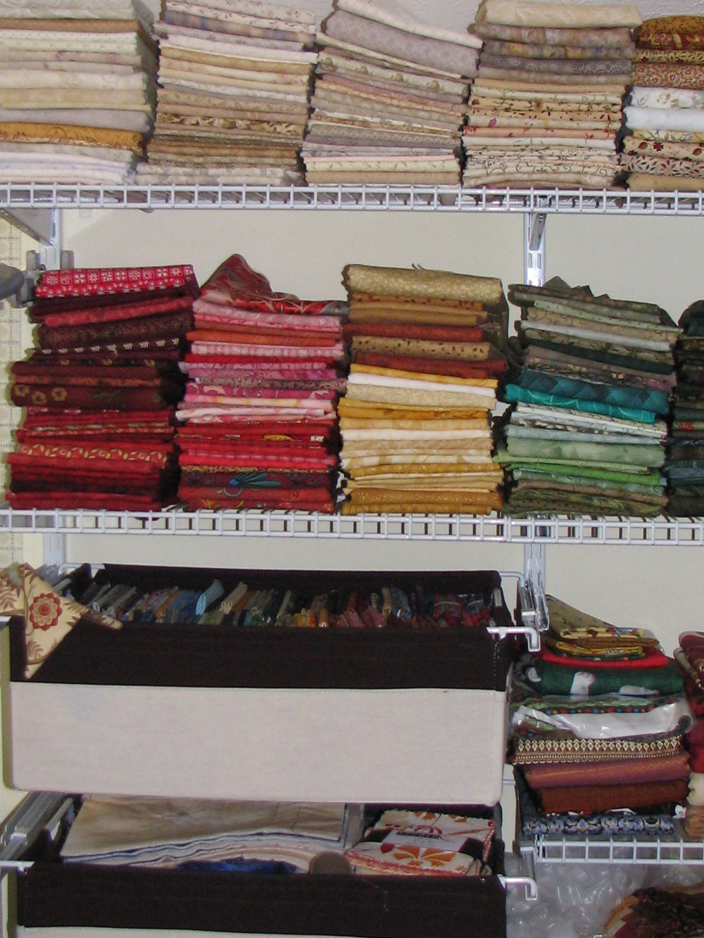 My stash when I first set up this shelving system. It doesn't look all that different now 10 years later. In fact, I even still have a lot of those same fabrics!
