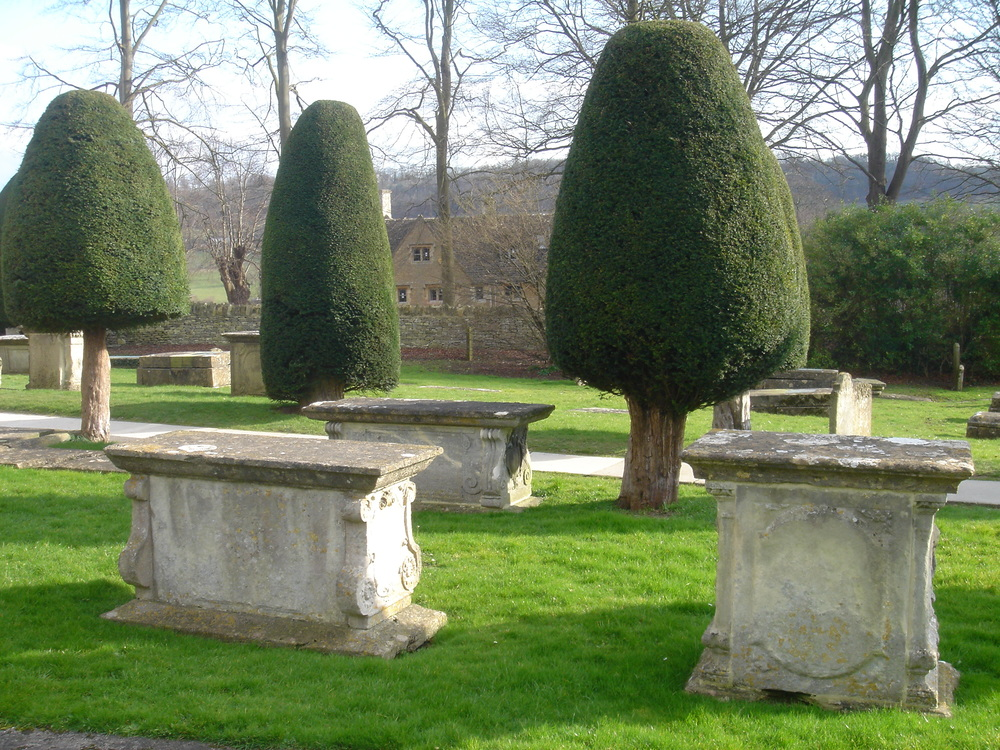 The church in Painswick is famous for both its yew trees and its tombstones.