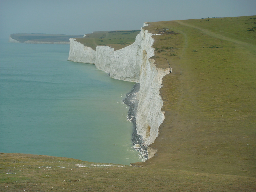 The eastern section of the South Downs Way parallels the white chalk cliffs of the English Channel.