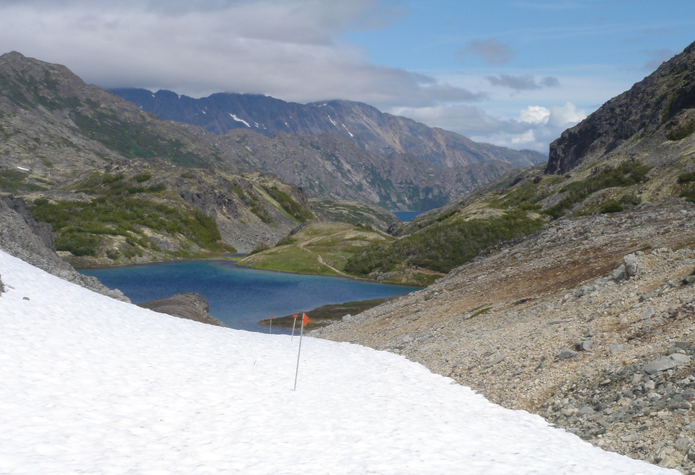 Flags mark the Chilkoot Trail over the snowfields at higher elevations.