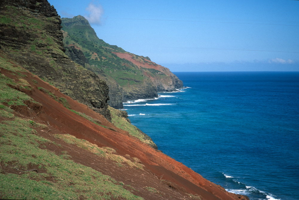 The rocks and soil along the Kalalau Trail reveal the volcanic origin of the Hawaiian Islands.
