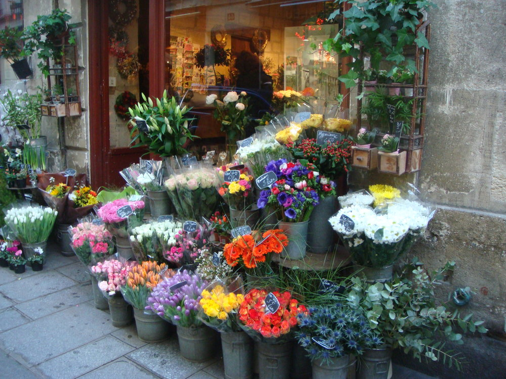 Walkers in Paris pass many traditional businesses, such as this flower shop on Ile de la Cite.