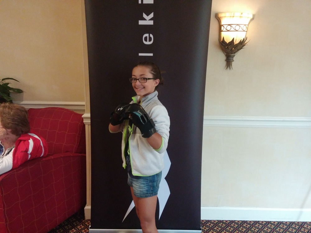 Hailey showing off her new whistlekick sparring gloves. She had her second consecutive pushup victory on Saturday.