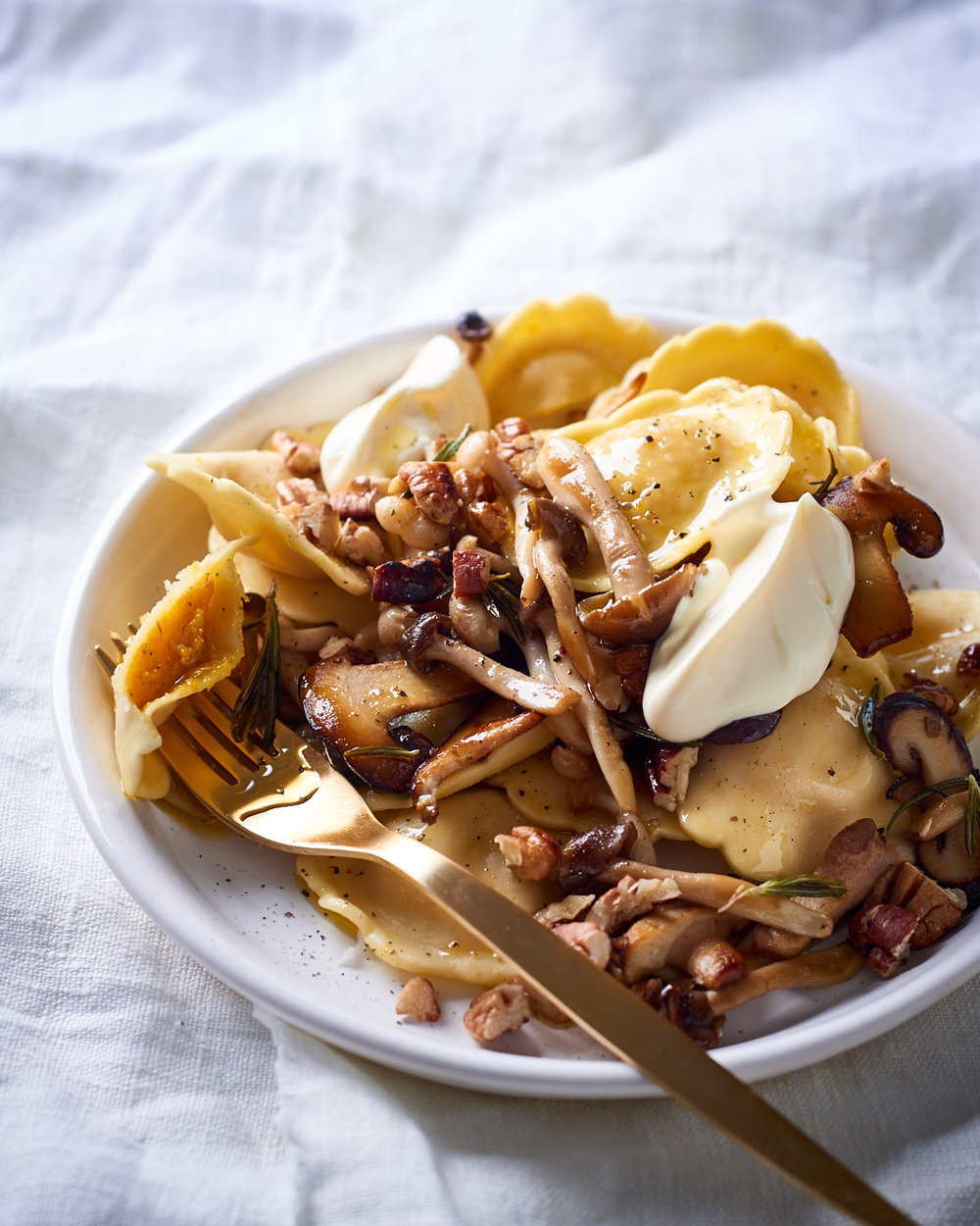 Butternut pansotti with buttery wild mushrooms, rosemary and pecan nuts