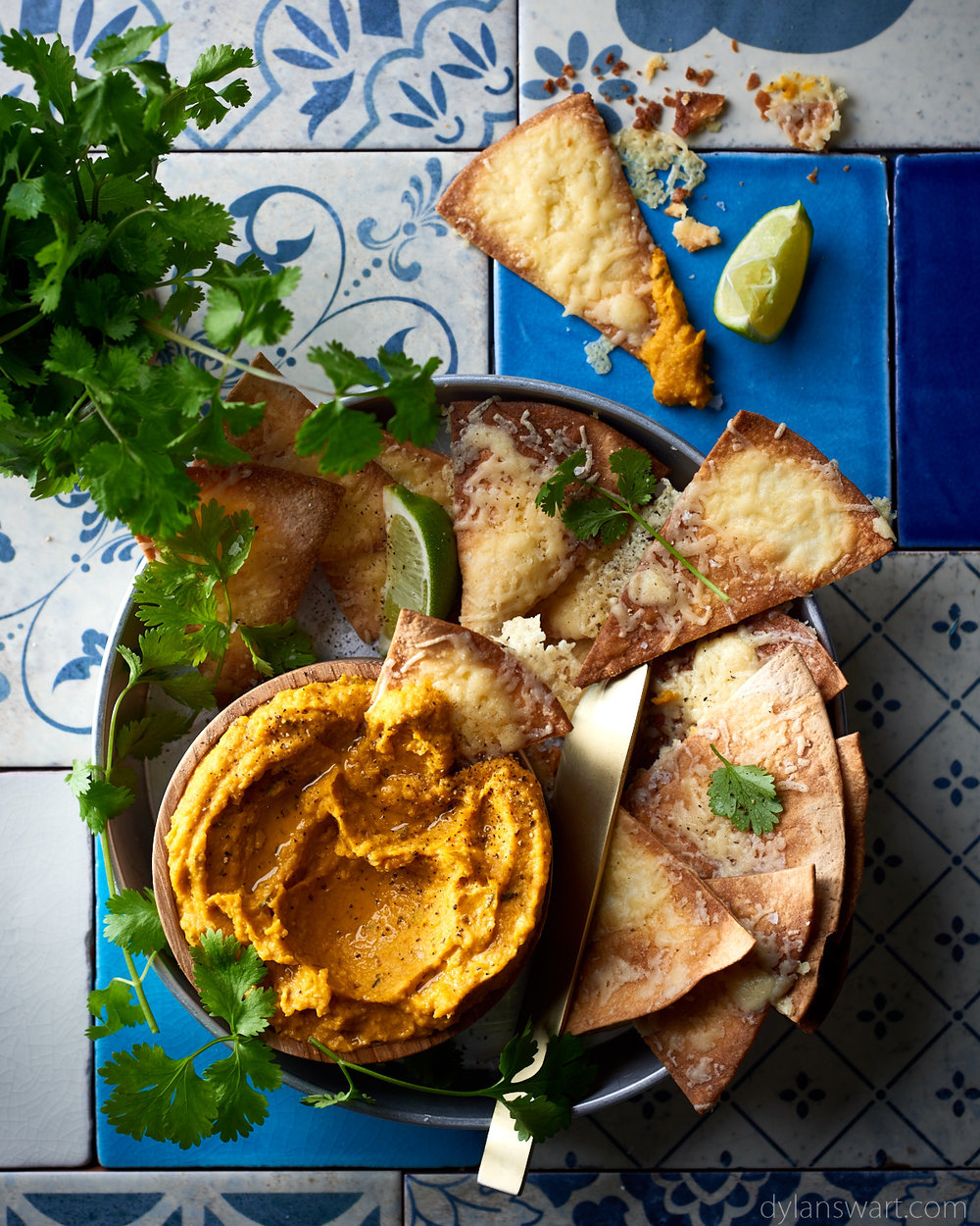Pumpkin, lime and chilli hummus with cheesy tortilla dippers