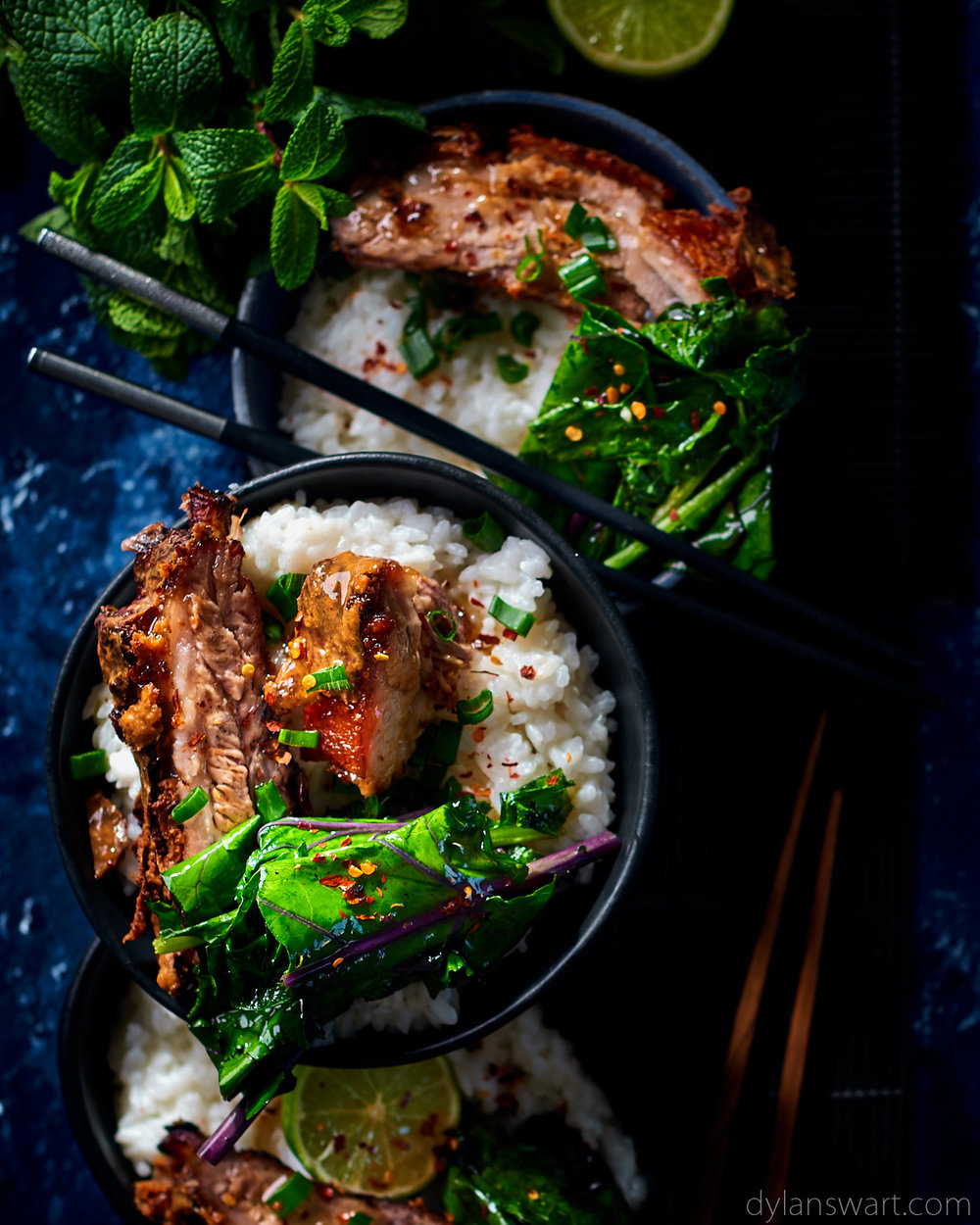 Coconut and lemongrass Asian bowls with slow-cooked pork belly and flash-fried greens