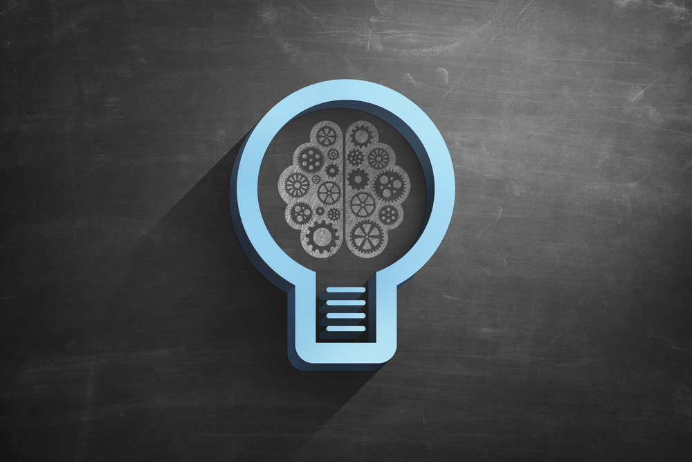 Illustrated light bulb and Brain on Blackboard.jpg