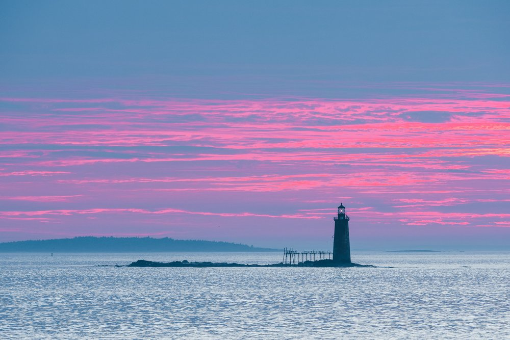 Sunrise view a light from Fort Williams Park in Portland, ME.