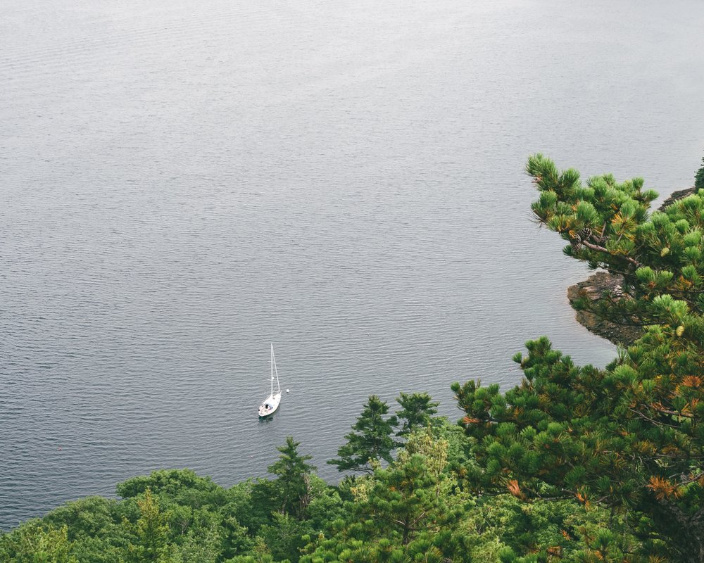 A lone sailboat from above.