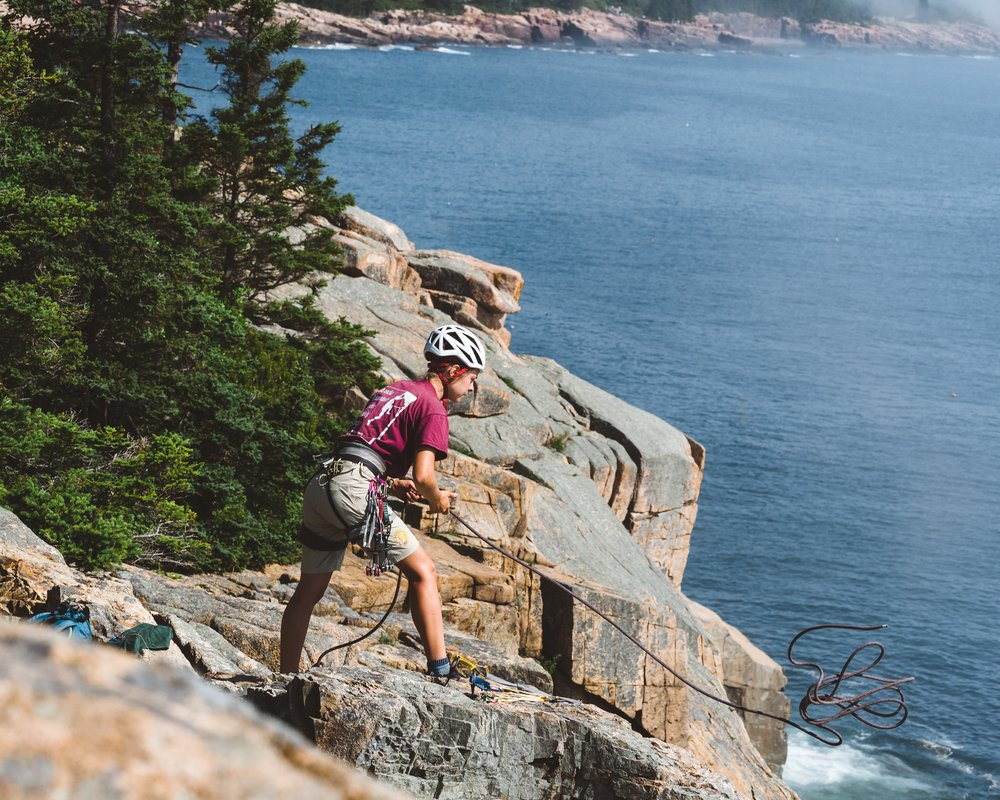 A climber prepares to descend Otter Cliff.