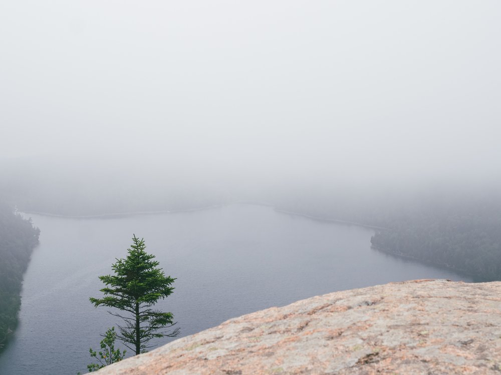 A foggy view from South Bubble down to Jordan Pond.