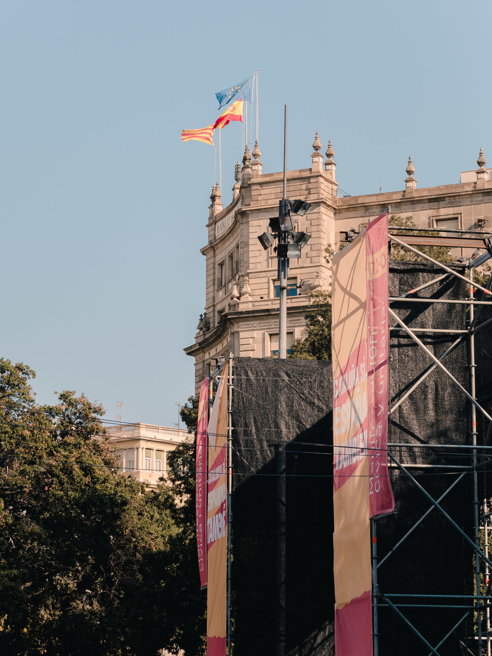 The leftover stage from a morning political demonstration on Catalunya Square.