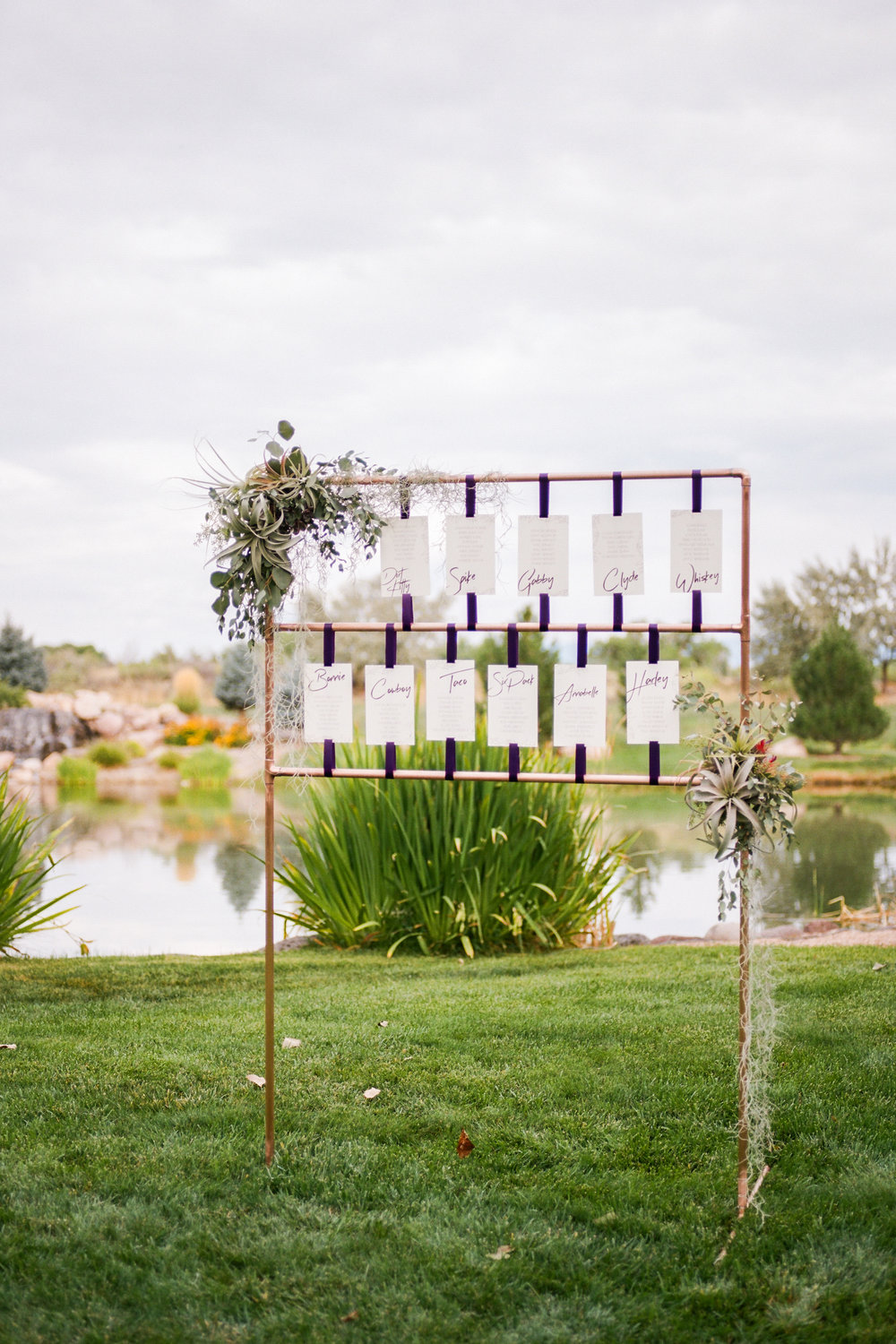 Copper + Airplants - The groom made a second copper structure for the seating chart display that we accented with more airplants, eucalyptus and hanging moss.