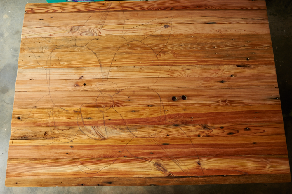 the transferred sketch to scale on our final wood piece.