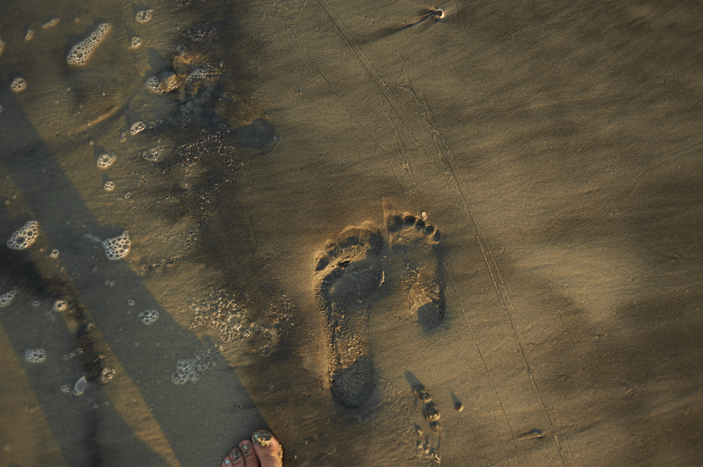 comparing my footprint with our youngest one's at Tybee.