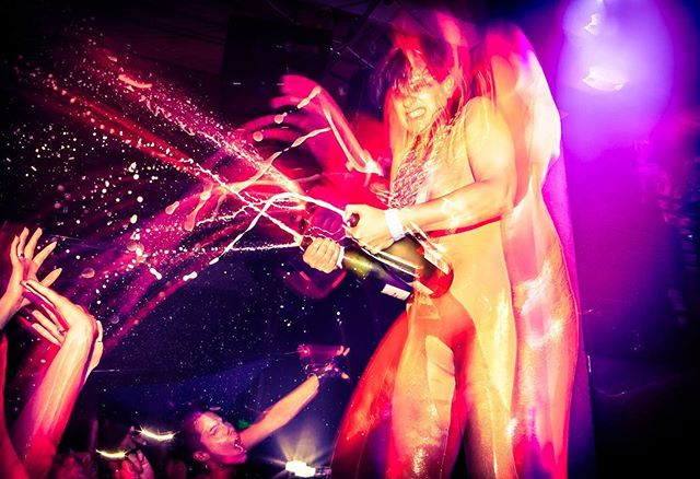 Champagne shower, courtesy of #peaches, at #mezzaninesf. I grabbed this shot... just before ducking to the floor and protecting my camera like a newborn baby!  #concertphotography  #flashphotography  #champagne  #electronicrock