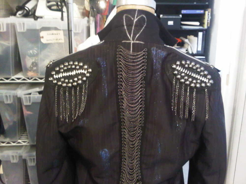 The symbol also became a key part of the clothing design that St. Jimmy and his followers wore. Above is a custom jacket made for Melissa Etheridge.