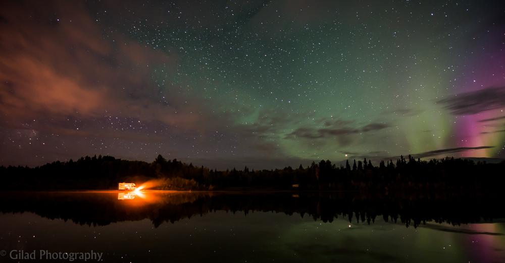 Northern lights reflecting on a lake in Alaska