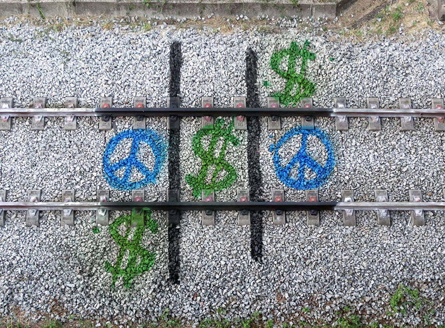 railway-train-tracks-portugal-street-art-artur-bordalo-4.jpg