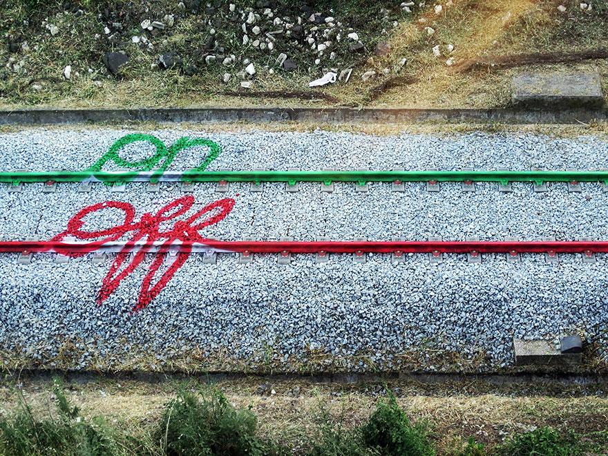railway-train-tracks-portugal-street-art-artur-bordalo-5.jpg