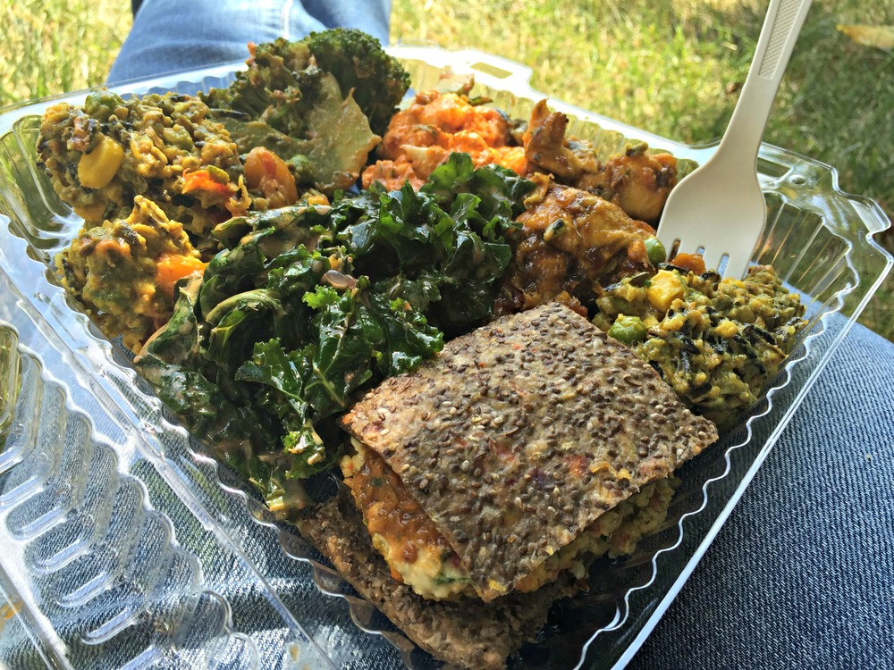 "Raw vegan goodness from  Khepra's   - almond hemp burger, cauliflower bites, curried wild ""rice"", broccoli and ""fried"" plantains"
