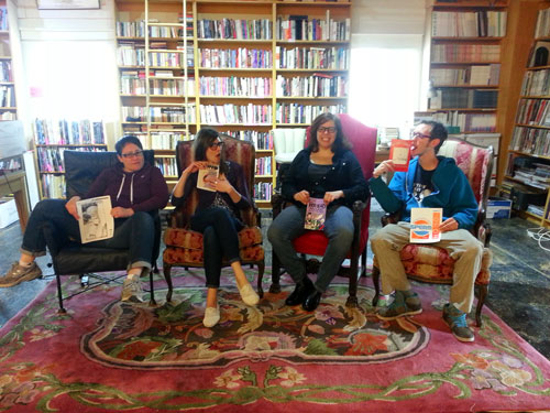 "The CSC Staff holds their favorite zines (from left to right): Tess McCarthy with ""Frighten the Horses,"" Betsy Foley with ""Deviant- The comic book journal of Strange Sex,"" Anissa Malady with ""Hothead Paisan""and Ian with ""Weenie-Toons!"" and ""Homoture #3."""