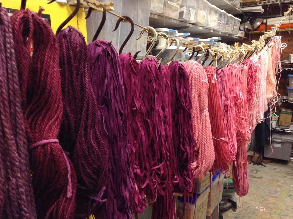 Wool yarn, cotton twine, twill tape, nylon cord hand dyed and hanging to dry