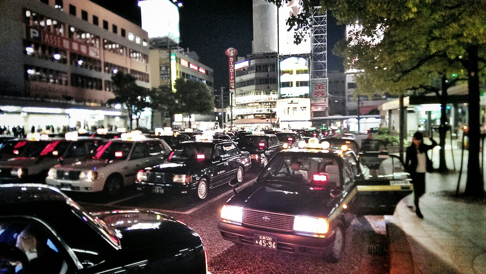 Cabs waiting outside the Hiroshima train station.