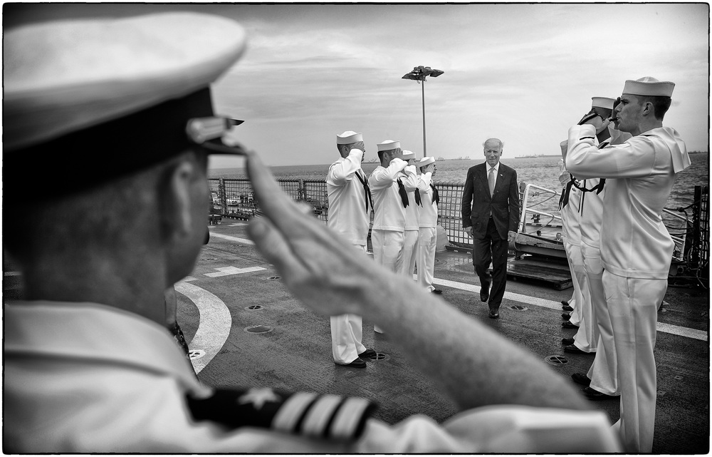 US Vice President Joe Biden receives a sideboy salute as he boards the USS Freedom.