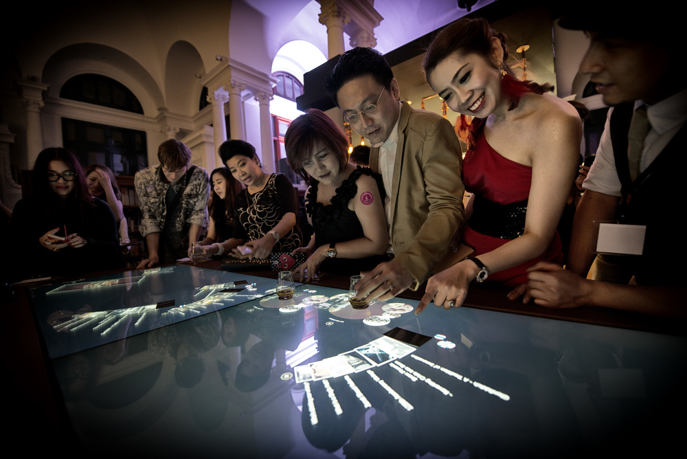Guests discover more about The Glenfiddich Experience through the use of a real-time interactive table designed by Make Studios.